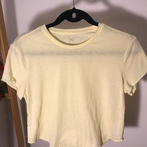 light yellow flowy cropped tee